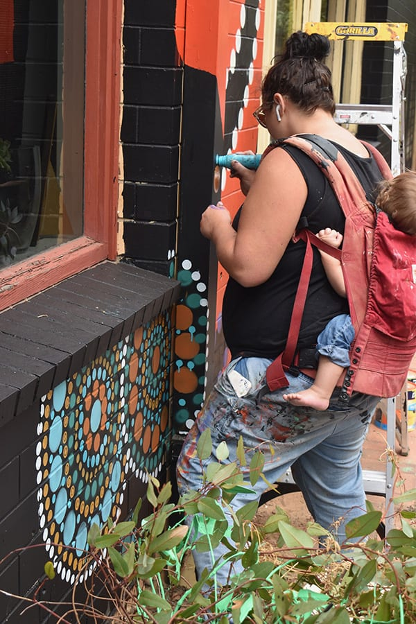 Sanaa artist creating street art Franklin Street Adelaide