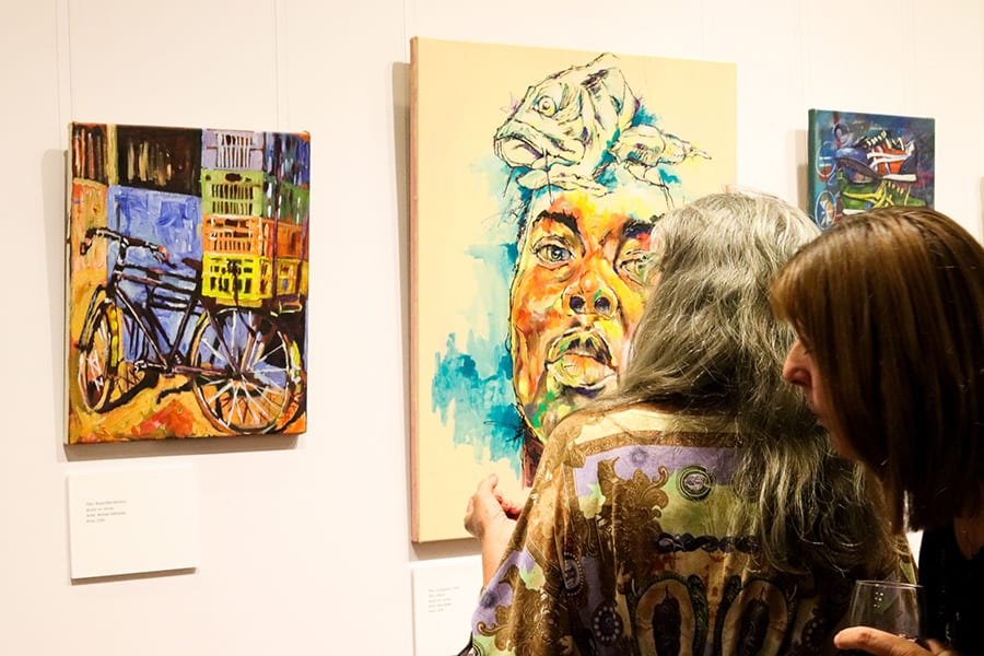 Admiring artwork at SANAA 2019 Exhibition Opening