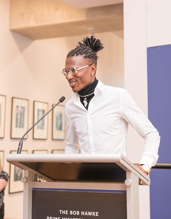 Artist Octopizzo speaking at SANAA 2019 Exhibition Opening