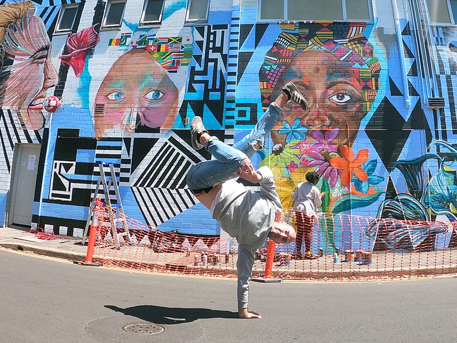 Breakdancer in front of street art, Percy Court, Adelaide
