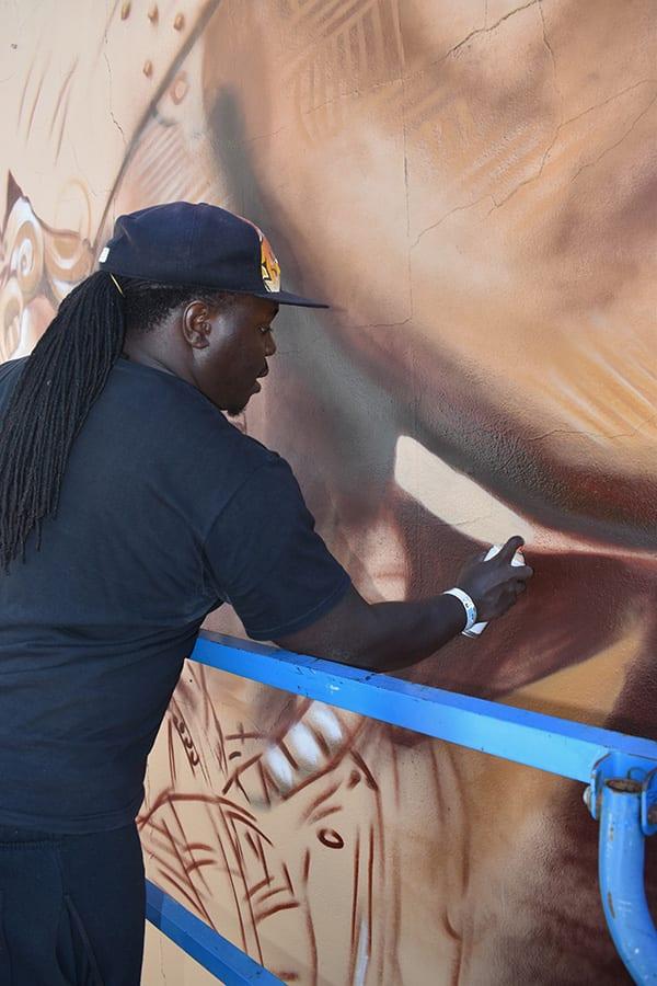 SANAA artist creating street art, Currie Street Adelaide