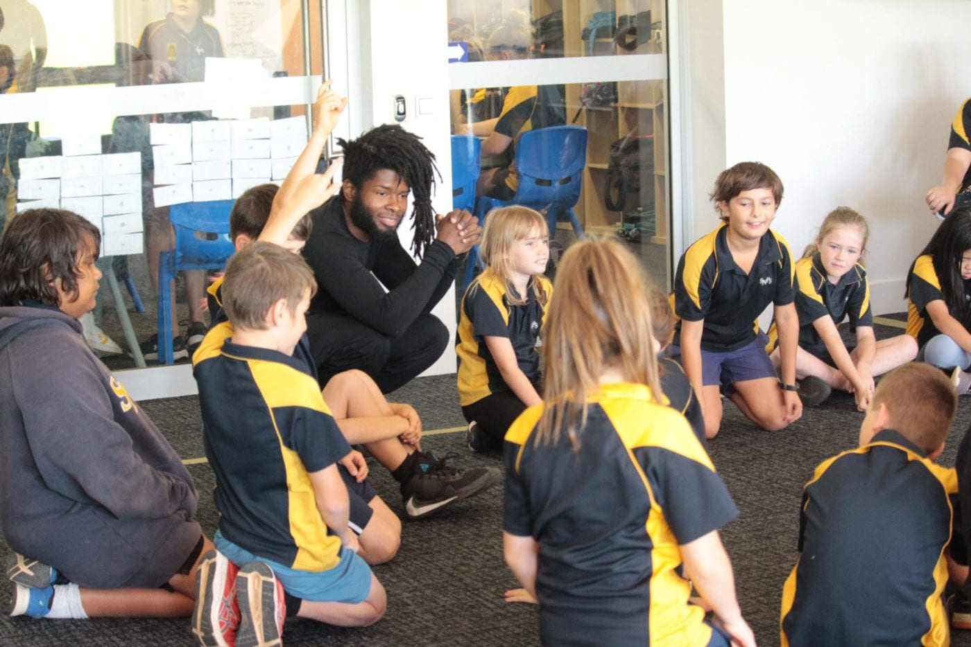 Performer and poet Chris Best leads a workshop with a school group in Port Augusta